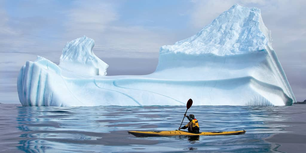 Sea kayaking near an Iceberg