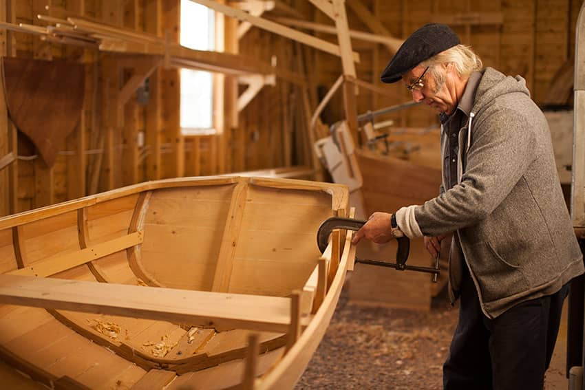 Working on a boat at the Wooden Boat Museum, Winterton NL