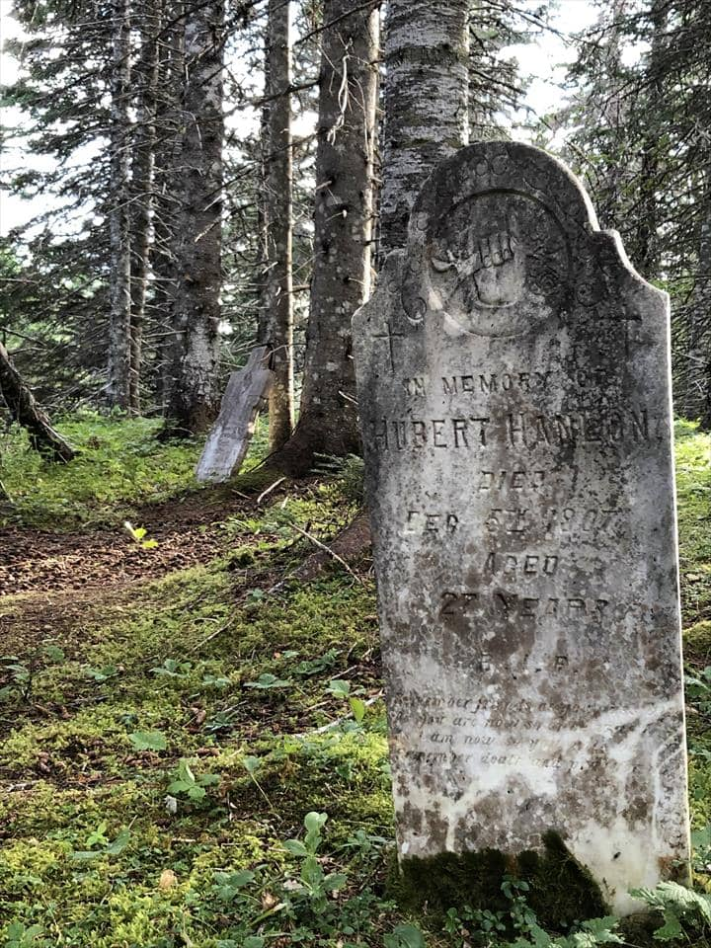An abandoned graveyard in resettled Julie's Harbour, Newfoundland