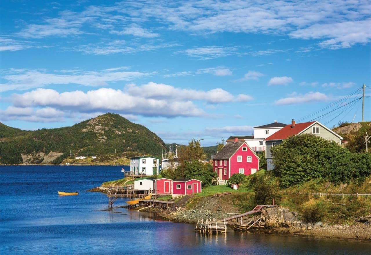 Colourful houses, blue ocean and shoreline in Saint Pierre and Miquelon